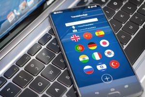 Foreign languages translation or learning languages online. Mobile phone or smartphone