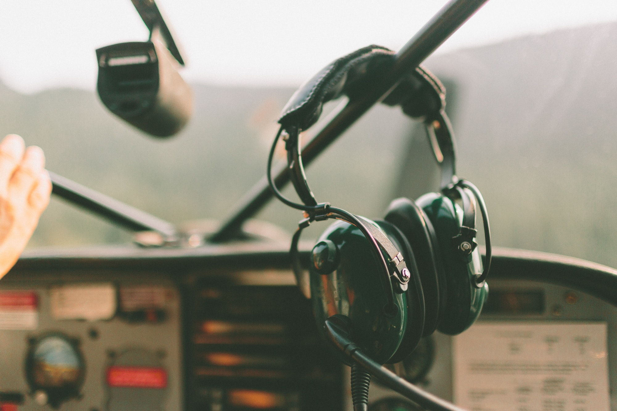 A head set in the cockpit of an airplane.
