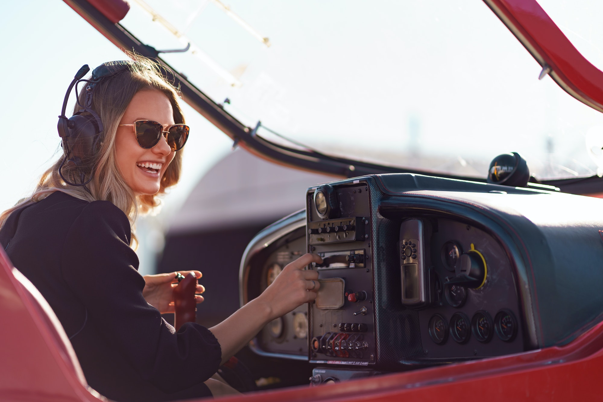Woman pilot operating on plane flying